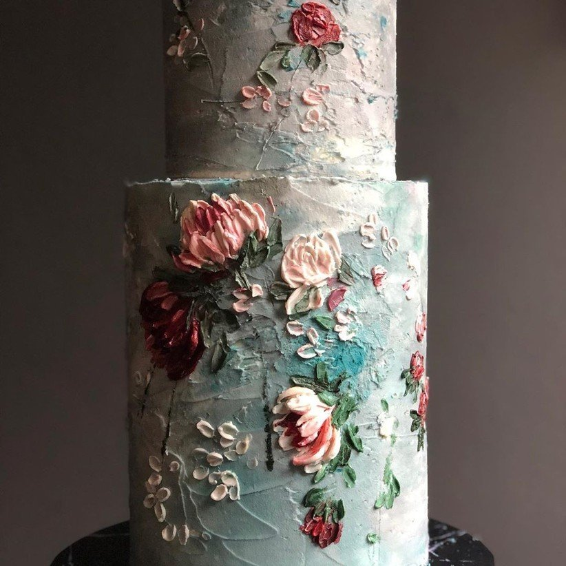 one of the most beautiful wedding cakes that is hand painted