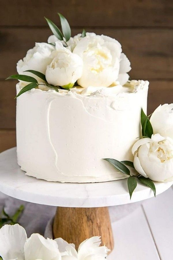 a simple white wedding day cake