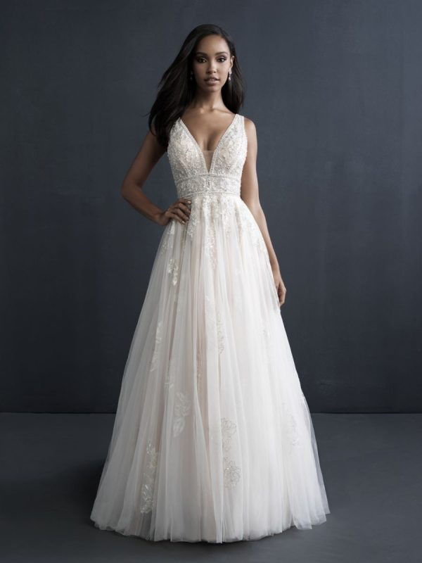 boho inspired wedding dress with lots of beaded and ball gown shape on bride