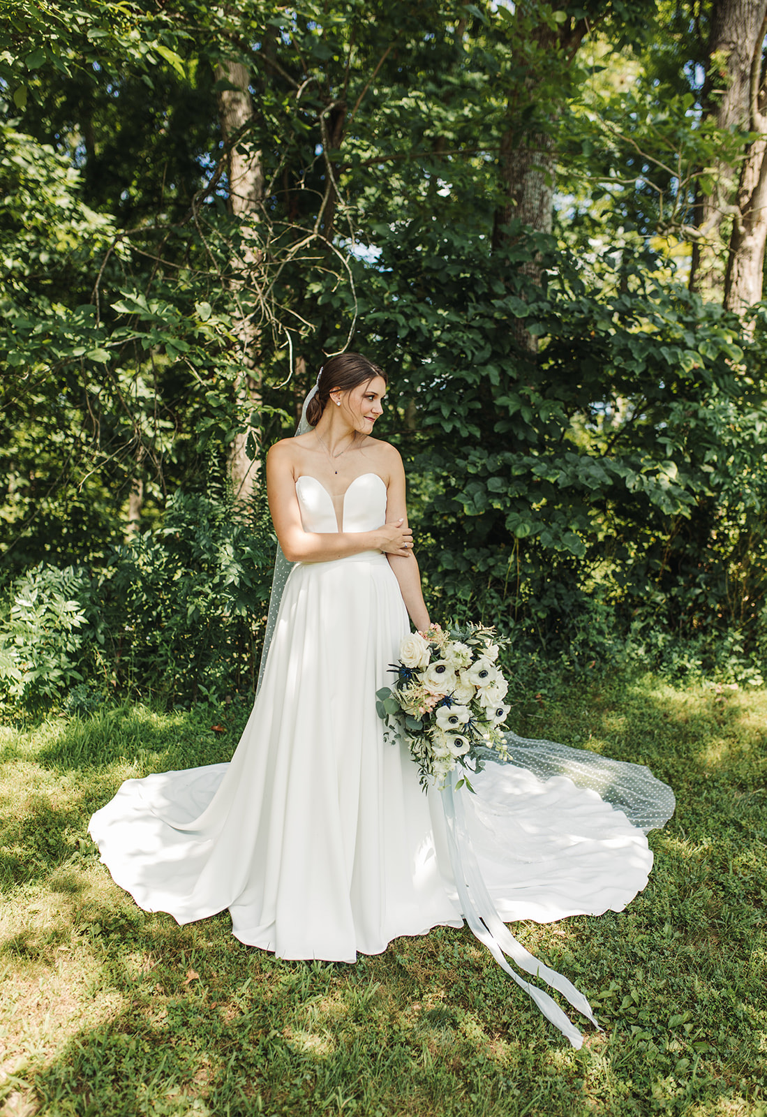 simple strapless aline wedding dress with a plunging v